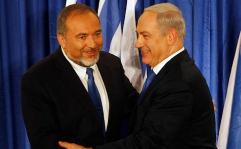 Benjamin Netanyahu and Avigdor Lieberman shake hands at a joint news conference in Jerusalem