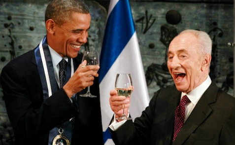 U.S. President Barack Obama toasts with Israel's President Shimon Peres after Obama was presented with the Presidential Medal of Distinction, Israel's highest civilian honor in Jerusalem