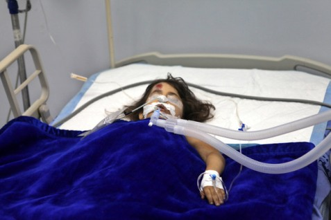 Six-year-old Toleen Asfour lies in a hospital bed on 19 October after she was hit by an Israeli motorist. Five-year-old Inas Khalil was killed in the same incident near the West Bank village of Sinjil. (Shadi Hatem / APA images)