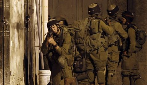 IDF soldiers in the West Bank village of Awarta, June 26, 2014. Photo by AFP