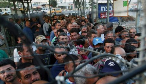Just another day. Palestinians on their way to work go through an army checkpoint near Jenin. Photo by AP