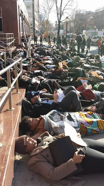 Legal Aid criminal attorneys having a die-in outside jail in Brooklyn. Part of Black Lives Matter protests.