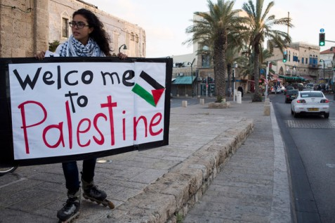 A young Palestinian marks Land Day in Jaffa, present-day Israel, March 2014. (Keren Manor / ActiveStills)