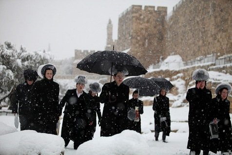 Ultra-Orthodox  Jews walk along the Old City walls