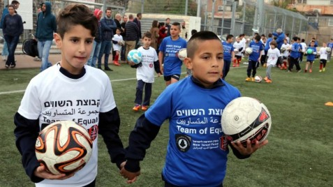 The children running slaloms through Hapoel Katamon's soccer field in south Jerusalem would be indistinguishable from one another, were it not for the blue and white T-shirts setting apart Arab from Jew. Read more: In Jerusalem, kids get a kick out of coexistence |  There IS HOPE for the future