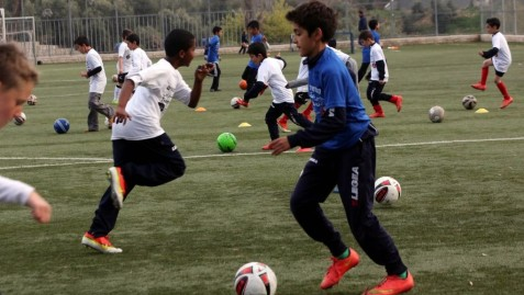 Children playing on Team of Equals practice soccer in Jerusalem, March 19, 2015 (photo credit: courtesy/Yossi Zamir)