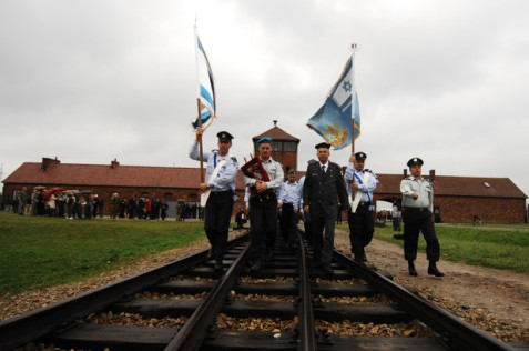 "An Israeli army delegation marches into Auschwitz-Birkenau Concentration Camp in 2007. (""Israel Defense Forces""/Flickr)"