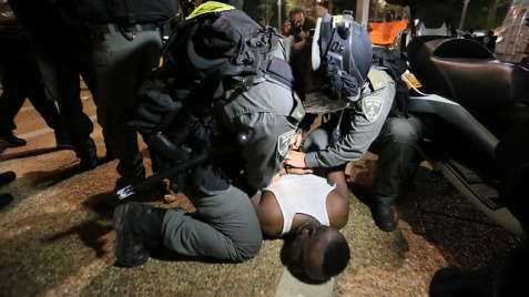 Ethiopian being arrested during the protest (Photo: Yaron Brener)