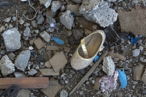A shoe belonging to Hala Bassam Madi, 3, lies in the ruins of her home in Rafah, southern Gaza, on 19 November 2014. The girl died in an Israeli air strike on 1 August 2014 that also killed her father Bassam, her mother Eman and her 2-year-old sister Jana. Her 3-year-old cousin Yousef was also killed, and a great-uncle later died of his wounds. Today, many of the ruins of destroyed homes have not been cleared and personal belongings remain scattered in the ruins.