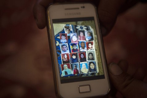 A photo stored on a mobile phone shows members of the al-Najjar family in the Bani Suheila, Khan Younis, southern Gaza Strip, on 19 November 2014. Nineteen members of the family, including 10 children, were killed in an Israeli attack on the night of 26 July 2014.