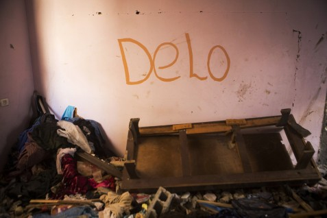 Delo, the nickname of Hadeel Abd al-Kareem Balata, 17, is seen written on the wall of her room which was destroyed during an Israeli strike on 29 July 2014 which killed the girl and 10 other members of the family in the Jabaliya refugee camp, northern Gaza, 14 September 2014. According to her surviving father, Hadeel was really gifted at school and wanted to be a doctor.