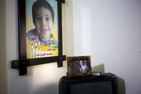 A photo of Issam Khalil Ammar, 4, is seen on the television in his parents' Gaza City apartment, 25 February 2015. Issam was killed with his sister, Eman (9) and brother Ibrahim (13) during an attack on a residential building on 20 July 2014. Eleven persons were killed in the building, including six members from the Hallaq family. The Ammar family still lives in the same building and their flat is full of the photos of the three children who were killed there.