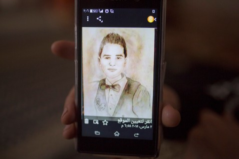 A portrait of Yousef Nasser Hussein Kullab, 15, drawn by one of his friends, is shown on a mobile phone in Rafah, southern Gaza, on 25 March 2015. Yousef was killed along with three members of his family, including two other children, in an Israeli attack on his home on 21 August  2014.