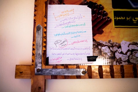 A letter written by 16-year-old Shireen Abu Madi mourning her father on the occasion of Eid al-Fitr, the holiday at the end of Ramadan, is glued to a poster commemorating the six members of her family killed in an Israeli attack in al-Nuseirat refugee camp, central Gaza Strip, 17 March 2015. Shireen lost her father and three brothers in the 2 August 2014 attack, as well as a 6-year-old nephew and 2-week-old niece.