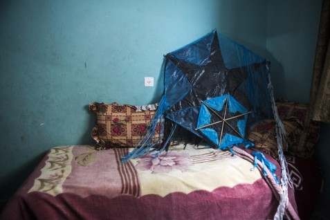 Kites made by 13-year-old Muhammad Amjad Abd al-Aziz Uwaida rest on his bed in Rafah, southern Gaza, 17 February 2015. The boy was killed along with his 5-year-old sister Amal on 5 August 2014 when they were on the roof to feed their pigeons. According to their mother, Tahrir, Muhammad was skilled at making things with his own hands and his parents keep the objects that he made, including the kites.