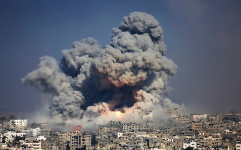 Smoke and fire from an Israeli strike rise over Gaza City in July 2014. (Hatem Moussa / AP )