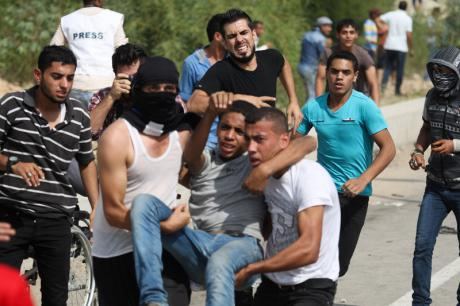Palestinian injured at Erez border crossing between Gaza and Israel, 13 October 2015. Demoted/Mhamed Hajjar. All rights reserved.