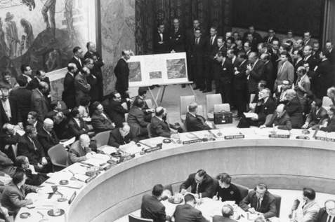 Adlai Stevenson shows aerial photos of Cuban missiles to the United Nations, October 25, 1962.