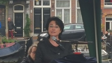 Joint (Arab) List MK Hanin Zoabi speaks at a Kristallnacht commemoration event in Amsterdam's Jewish quarter on November 8, 2015. (Matt Lebovic/The Times of Israel)