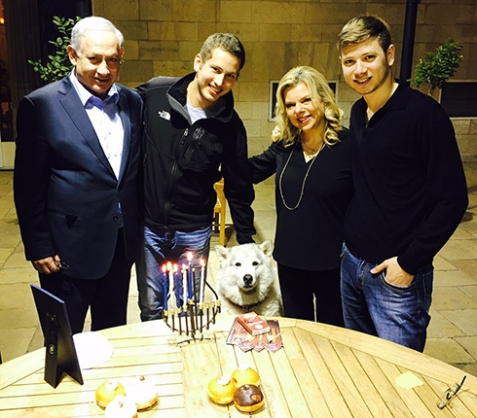 The Netanyahu family with their dog, Kaia