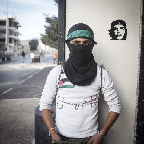 """A Palestinian youth in Bethlehem wearing a t-shirt with the hashtag """"Bahamish"""" written on it. """"Some shout 'Bahamish' to the soldiers. It means 'it's ok' or 'nevermind.' But if they kill us, this is not 'bahamish;' it's important."""""""