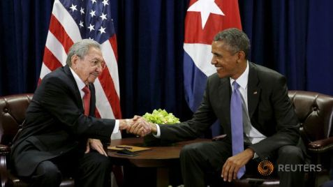 Historic Photo ~ US President Barack Obama (R) and Cuban President Raul Castro shake hands at the start of their meeting at the United Nations General Assembly in New York