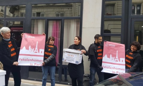 "Undeterred by arrest of an activist days earlier, members of BDS France wear ""illegal"" t-shirts calling for the boycott of Israel, during a protest outside Airbnb's office in Paris on 10 March. (Courtesy of BDS France)"