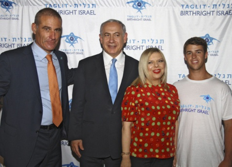 Left to right, is of Gidi Mark, CEO of Taglit-Birthright Israel; Israeli Prime Minister Benjamin Netanyahu; Netanyahu's wife, Sara Netanyahu; and Ohio State University student Ryan Hunter of Syosset, NY, at a Birthright Israel Mega Event on June 24, 2014, in Caesarea, Israel. (Photo is courtesy of Steinreich Communications).