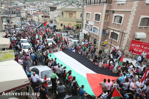 Palestinians from the Galilee town of Sakhnin commemorating Land Day, March 30, 2013. (Photo by: Yotam Ronen/Activestills.org)