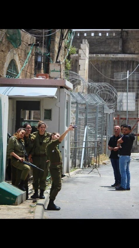 The 3 Palestinian men waited too long in order to pass the checkpoint, the female soldiers were busy taking selfies