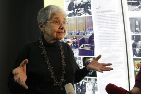 "Hedy Epstein: ""In the background you see the courtroom in which the doctors were tried & see some of the defendants sitting in the dock. Above that is a photo of the freezing experiment. A person is lying in a large vat of freezing cold ice water. Two doctors, one of them Dr. Rascher, are observing. Many people died as a result of this experiment."" --Nuremberg Palace of Justice (Photo: Newsweek)"