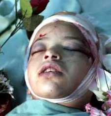 Israeli soldiers shot Sabreen Abu Sneineh, 8, in the head, in Hebron, Aug. 12, 2001. She was walking to school.