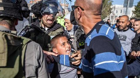 The file photo shows Israeli forces arresting a Palestinian boy in front of his school in East al-Qud