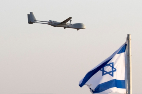 An Israeli UAV Hermes 500 flies over the Hatzerim air force base in the Negev desert, near the southern  city of Beer Sheva, on June 30, 2016 during an air show at the graduation ceremony of Israeli pilots. / AFP PHOTO / JACK GUEZ  File photo of an Israeli drone (AFP)