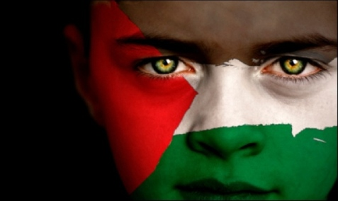 Portrait of a boy with the flag of Palestine painted on his face