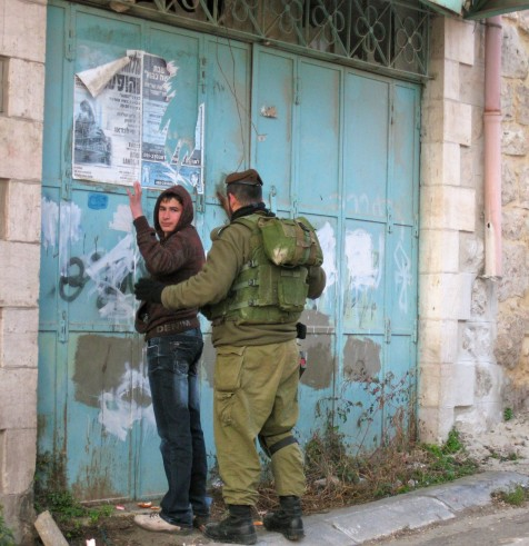 An Israeli soldier searches a 15 year old boy in Hebron. One of the many incidents that takes place in Hebron that many Israelis don't know about.