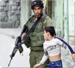 Photo that Israel does not want you to see .... child being harassed by ziocop in Gaza Ghetto