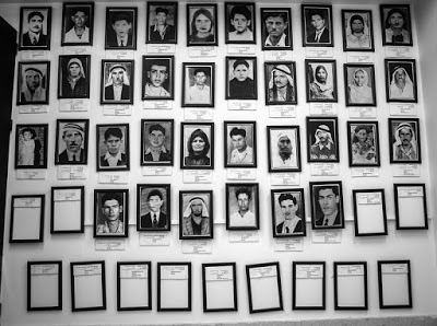 Photographs of the victims are displayed at the Kafr Qassem Massacre Museum. (Photo credit: Dylan Collins)