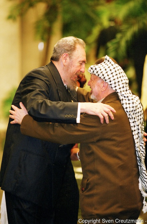 Cuban President Fidel Castro greets Palestine leader Yasser Arafat, right, at a dinner reception.