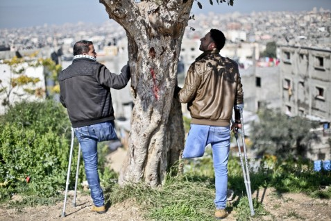 Adli (right) and Mansour (left) on top of al-Muntar hill, the highest point in the Gaza Strip, near where Mansour was injured in an Israeli strike.